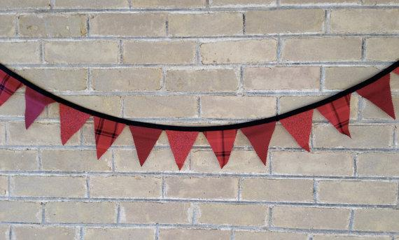 Red Christmas garland - on a brick wall
