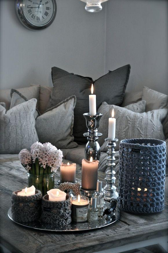 Romantic table decoration - with candles and small lilac flowers