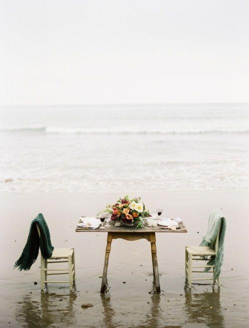 Romantic table on the beach - with two chairs