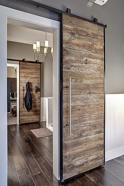 Rustic sliding hallway door - inside an eclectic home