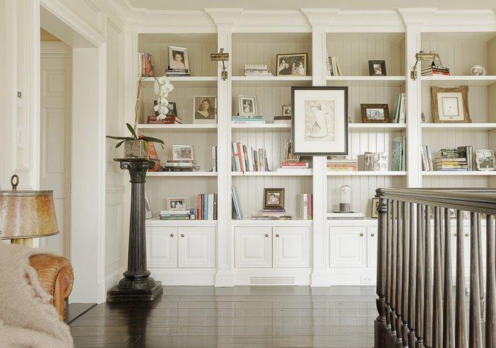 Second floor hallway bookcase design - with books and paintings