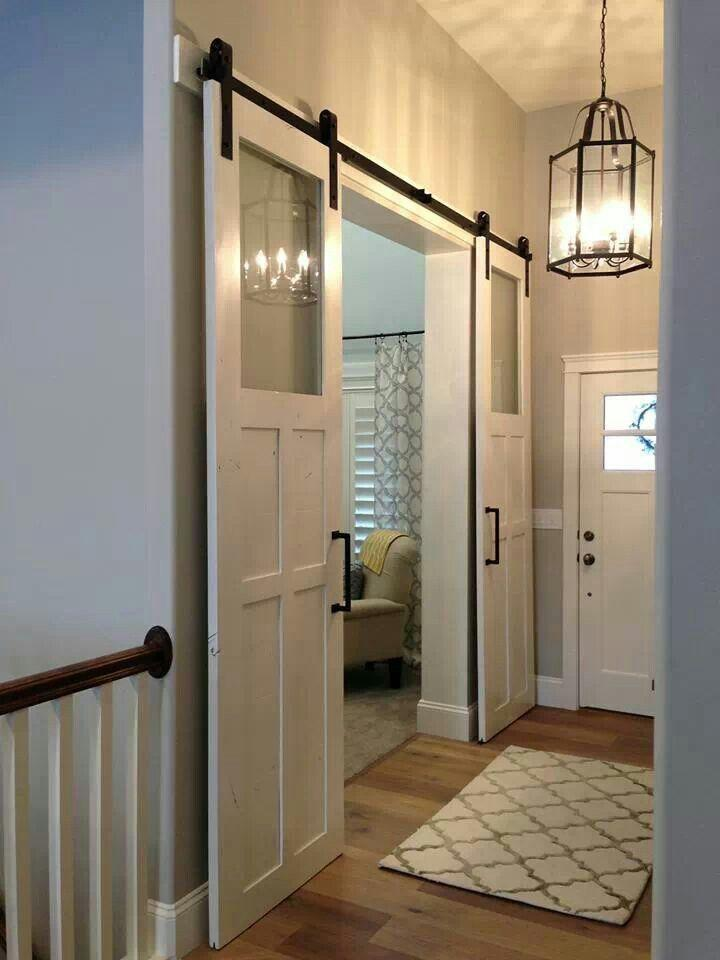 Simple sliding hallway door - inside a traditional home