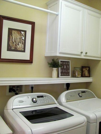 Small laundry cabinets - above the shelf