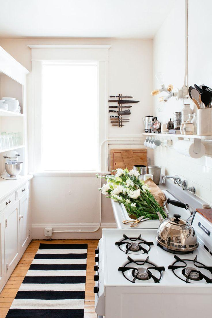 Small white kitchen - with striped rug