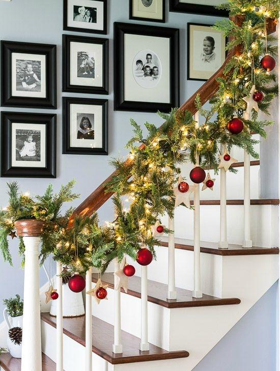 Christmas garlands for stairs fireplaces and lights for Hanging garland on staircase