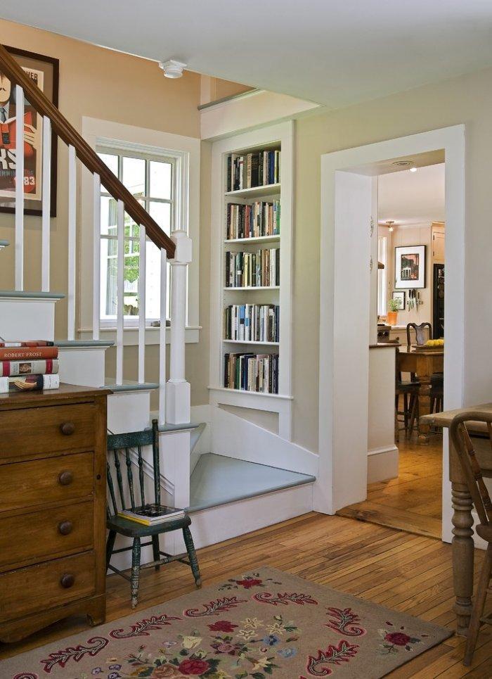 Staircase bookcase design - in white color