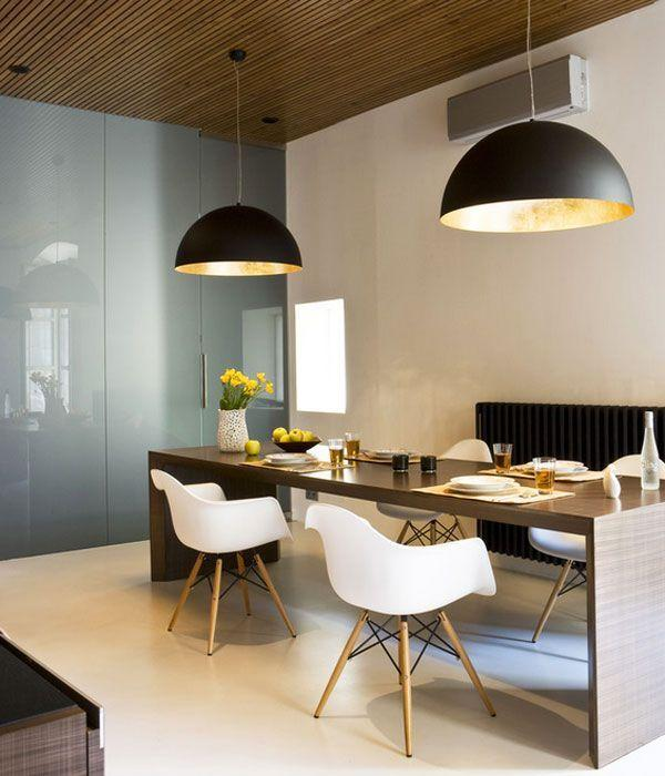 Stylish black modern pendants - placed in the dining room