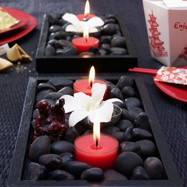 Table With Chinese Decoration 2 Red Candles And White Flowers
