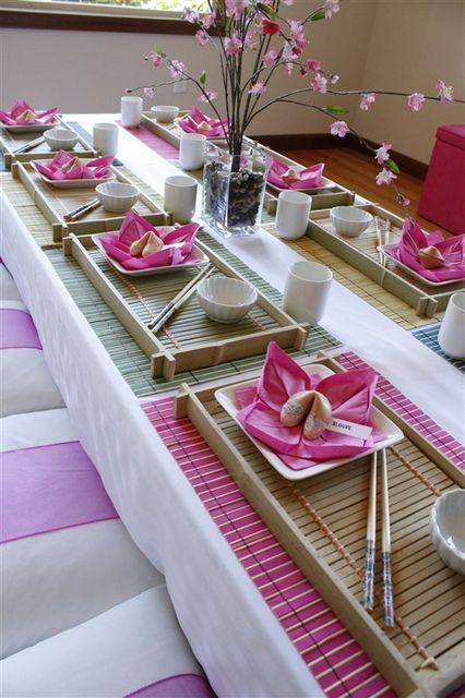 Table with chinese decoration - pink napkins with fortune cookies
