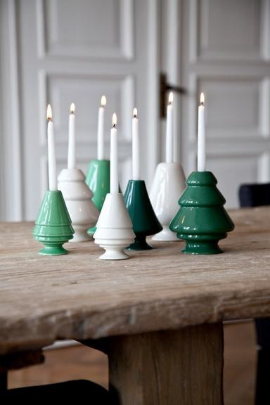 Tiny white candles - on white and green holders