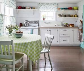 Kitchen with interesting yellow table cloth