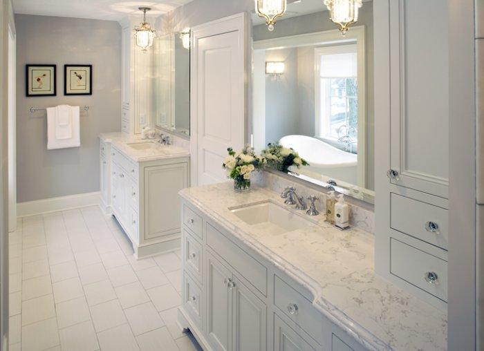 White Corian countertops - in a traditional luxurious bathroom