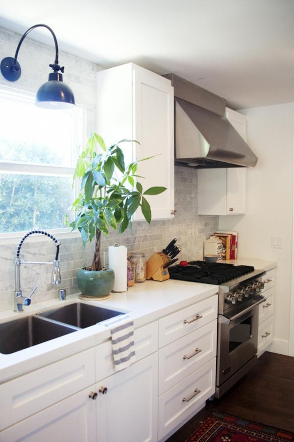 White Corian kitchen countertops - in a small traditional cooking room