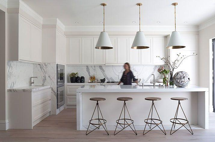 White modern pendants - used in a traditional kitchen