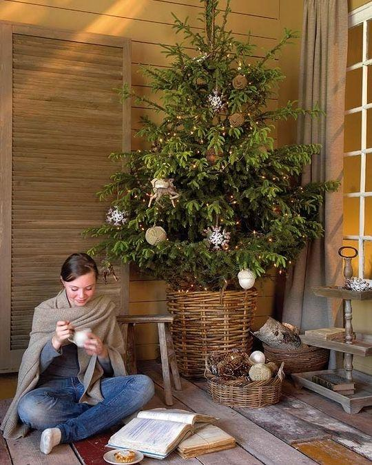 Wicker Christmas tree skirt - and woman sitting next to it