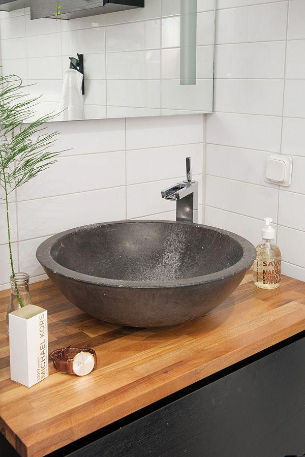 Wooden bathroom basin countertop - with dark bowl above it