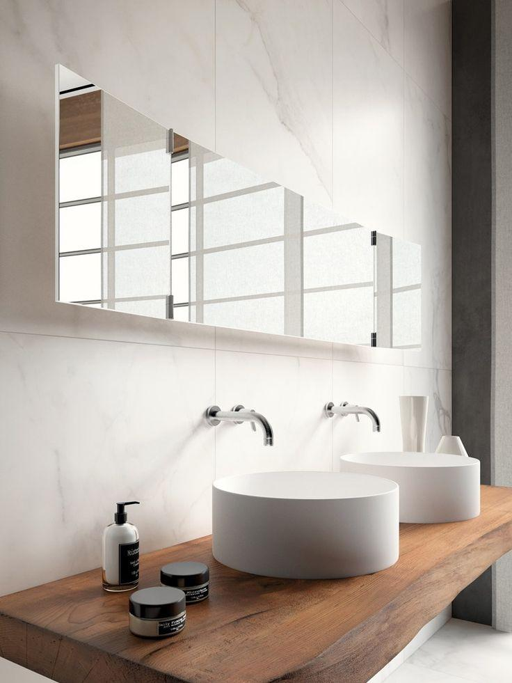 Wooden countertop below ceramic bowls - inside a stylish small bathroom