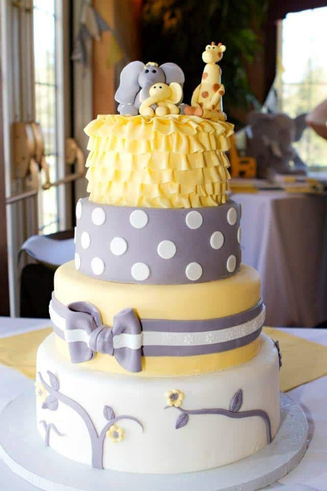 Yellow and grey baby shower cake - with funny animals on the top