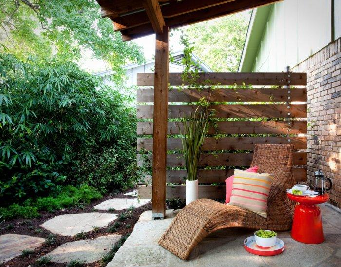 Brown pallet fence - for a garden lounge