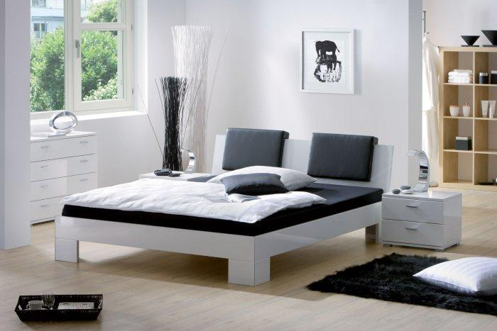 Contemporary designer bed- in sunny room