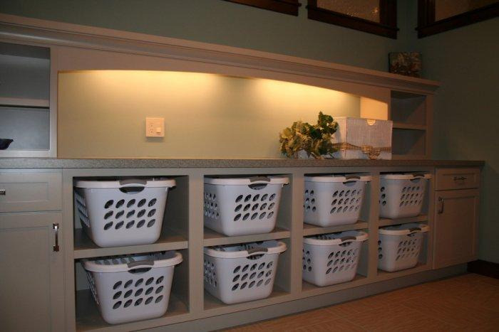 Contemporary shelves with baskets for storage - in the laundry