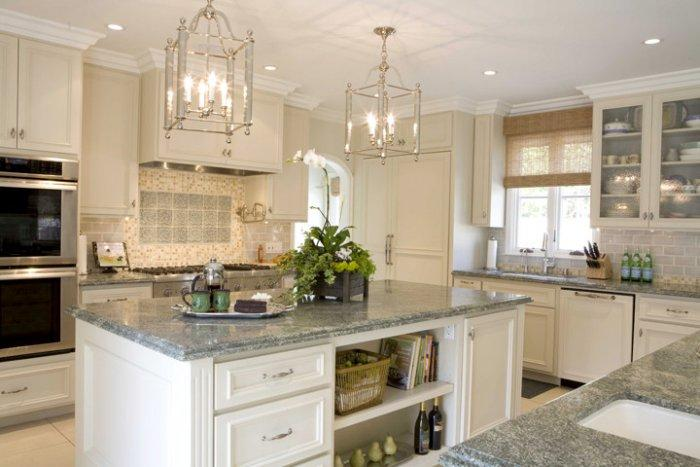 Costa Esmeralda Granite Countertop And White Painted Cabinets