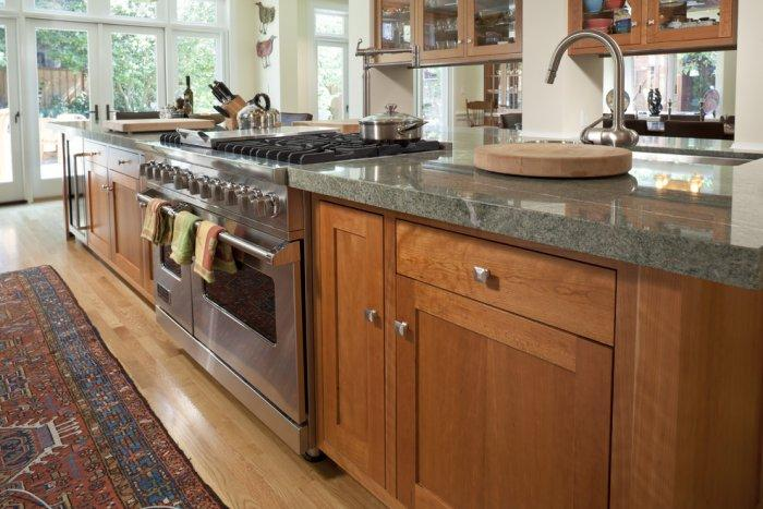 Dark Costa Esmeralda Granite Countertop - and stain-grade cabinets