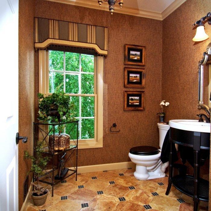 Dark ceiling cornice - inside a traditional powder room