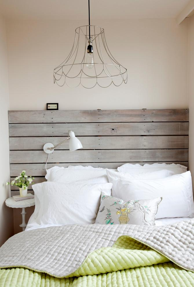 Farmhouse pallet headboard - in a vintage bedroom