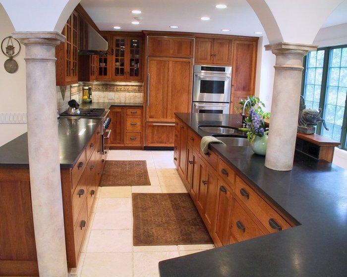 Granite Countertops in Absolute Blackcolor - and oak cabinets