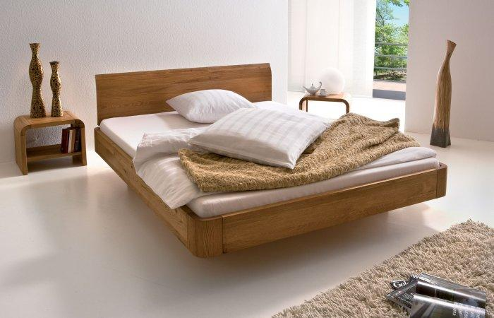 Massive designer bed - with wooden frame and headboard
