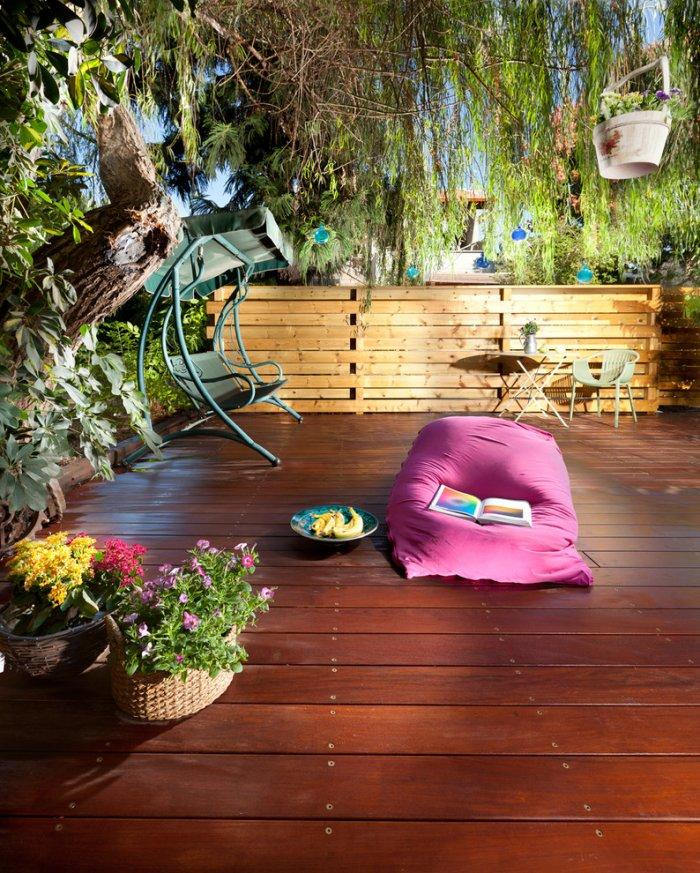 Natural pallet fence - and wooden deck