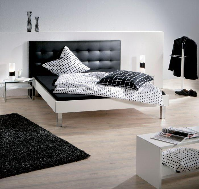 Small designer bed - with black leather headboard
