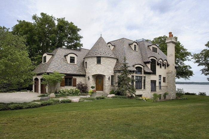 Towered French style eclectic mansion - with stone cladding