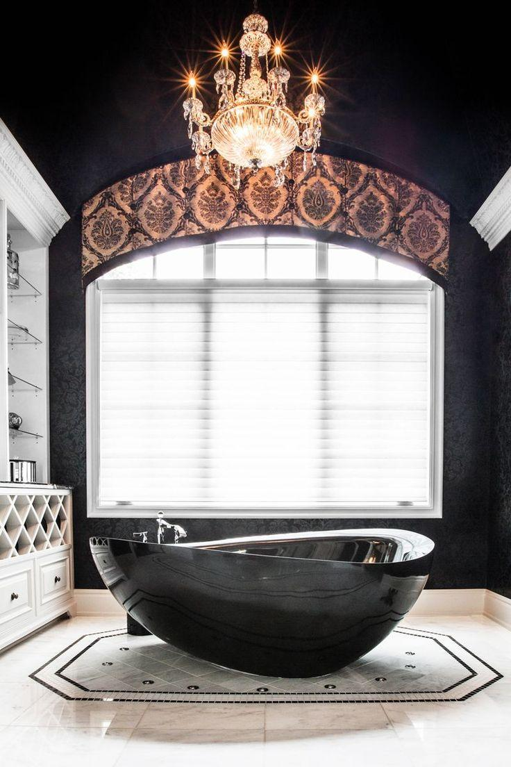 Contemporary black luxurious bathtub - in an eclectic bathroom