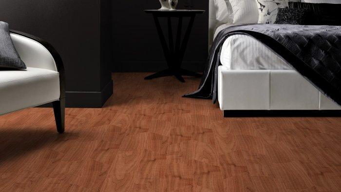 Dark bedroom with designer flooring - with wooden panels