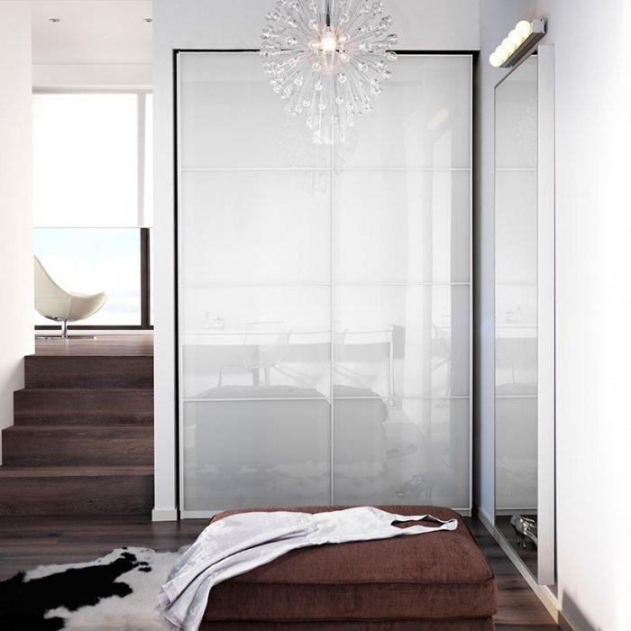 Minimalist bedroom wardrobe - with white polished doors