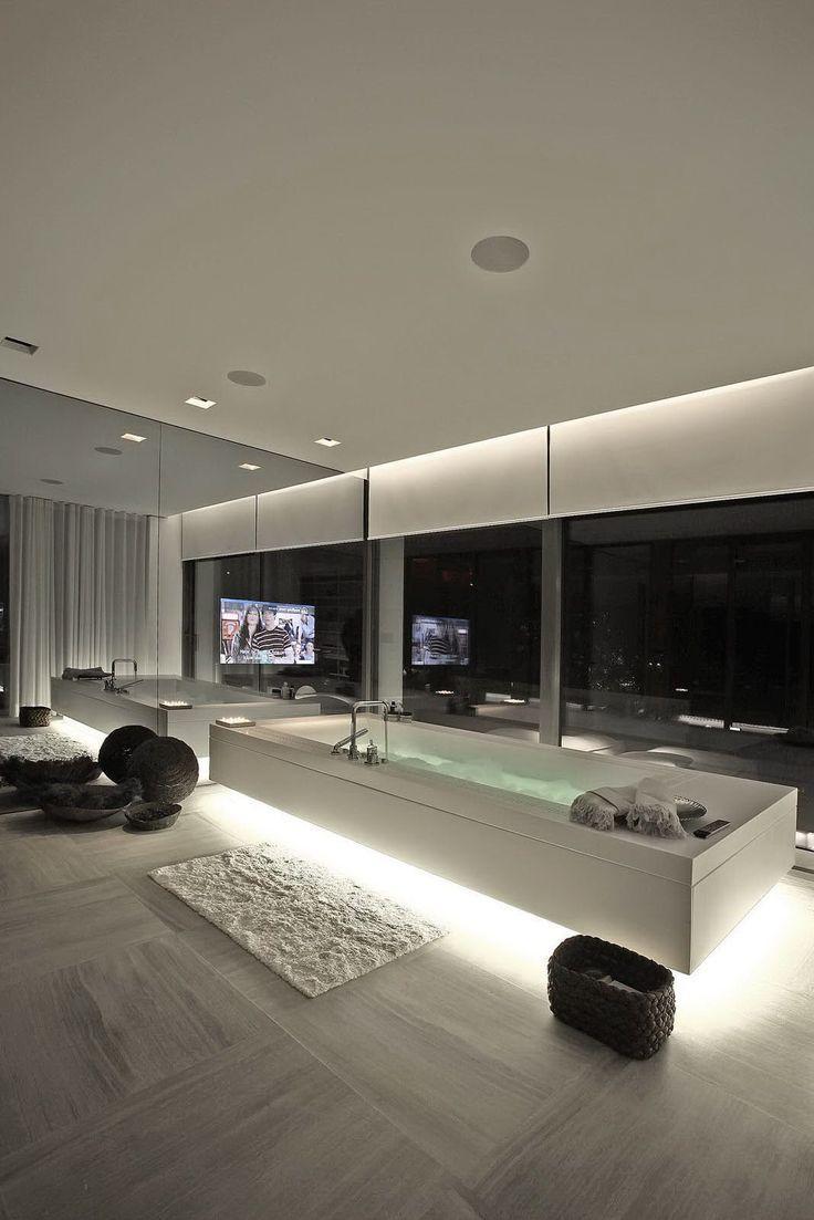 Minimalist white luxurious bathtub - inside an expensive home