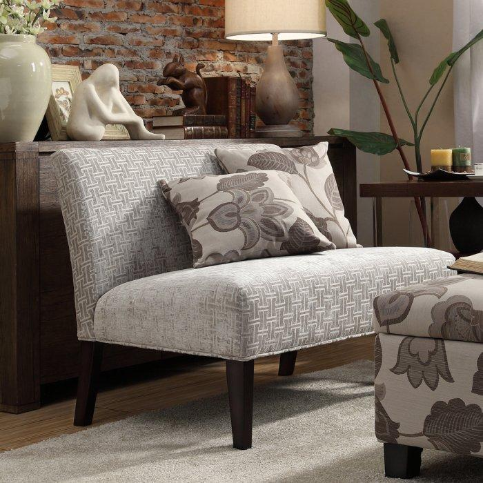 Pale loveseat sofa - with patterned upholstery