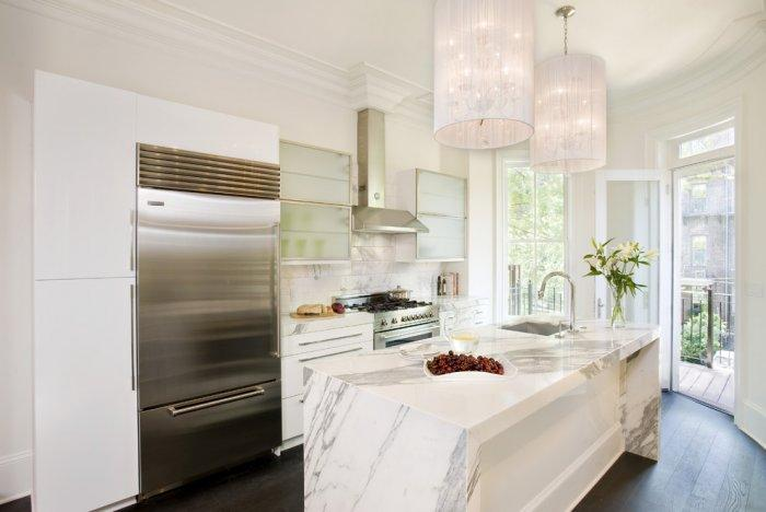 Shiny marble kitchen countertop - in a luxurious cooking room