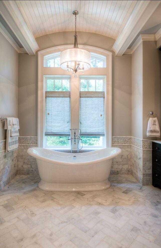 White luxurious bathtub - inside a classic bathroom