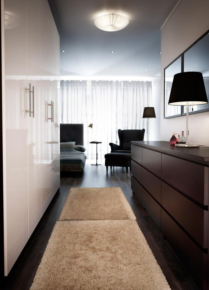 White polished bedroom wardrobe - in a modern home