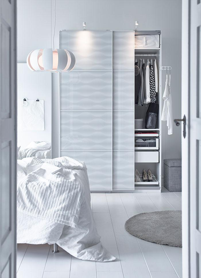 White stylish bedroom wardrobe - in a contemporary room