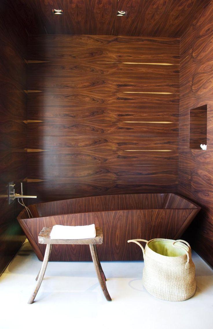 Wooden luxurious bathtub - inside a modern bathroom
