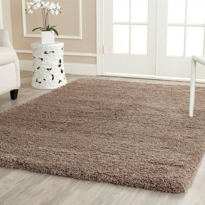 Beige area rug - with fluffy surface