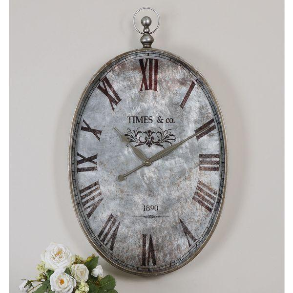 Old metal wall clock - with Roman numbers