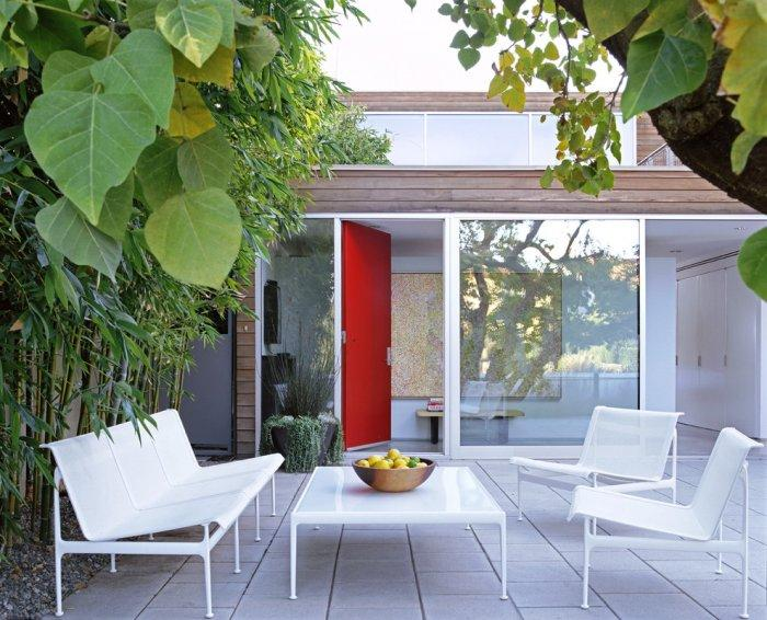 White modern outdoor bench - and two white chairs