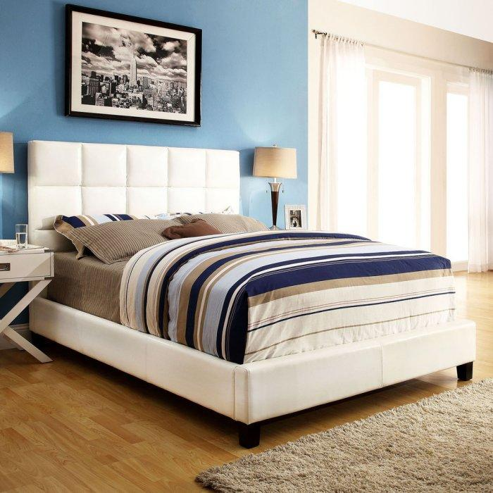 White platform bed - with colorful sheets