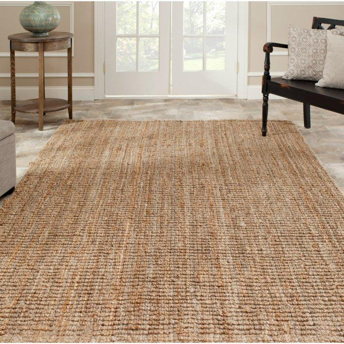 Woven area rug - with raw structure