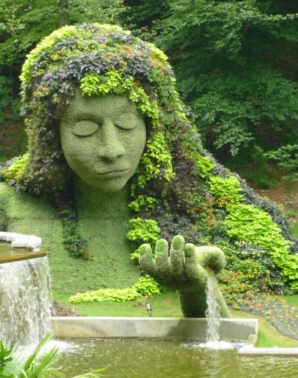 Stone garden sculpture - woman